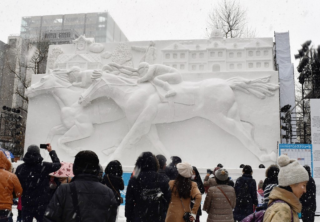Oh, snow! Warm winter woes for famed Japan festival