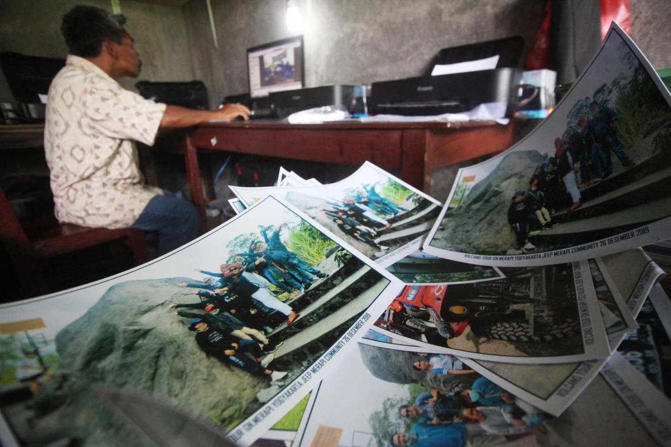 High demand: Photographs are printed on a number of printers to ensure speedy service. JP/Boy T Harjanto