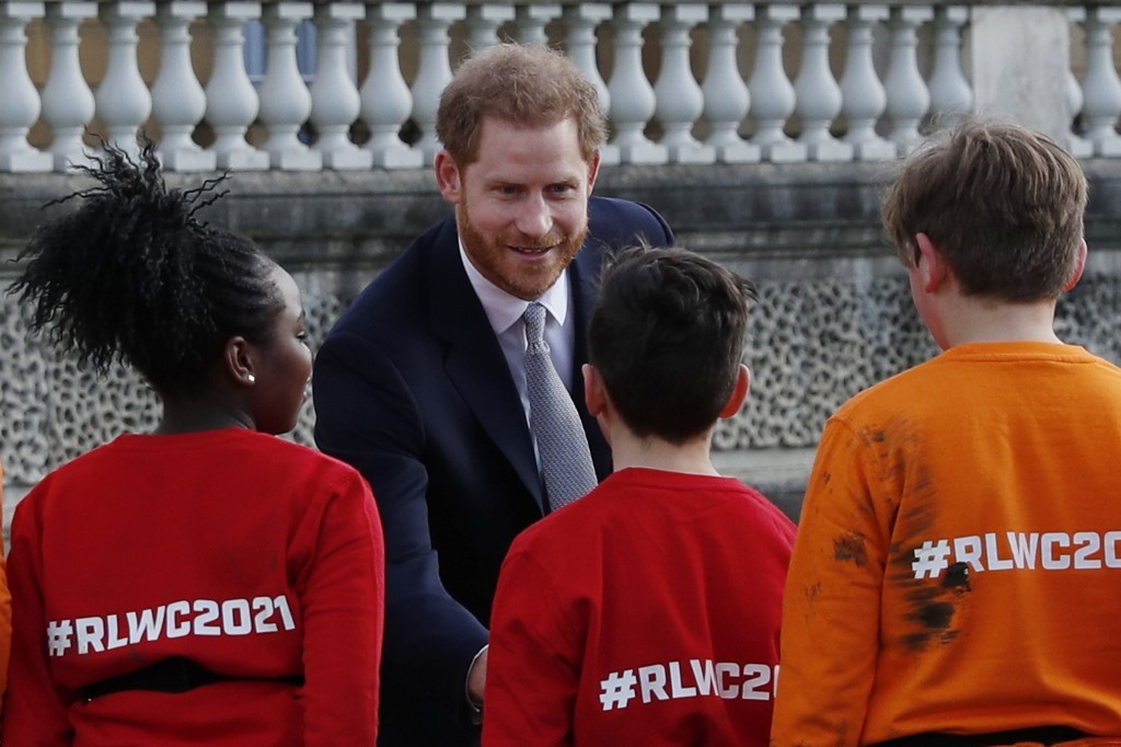 Prince Harry resurfaces but stays silent on royal rumpus
