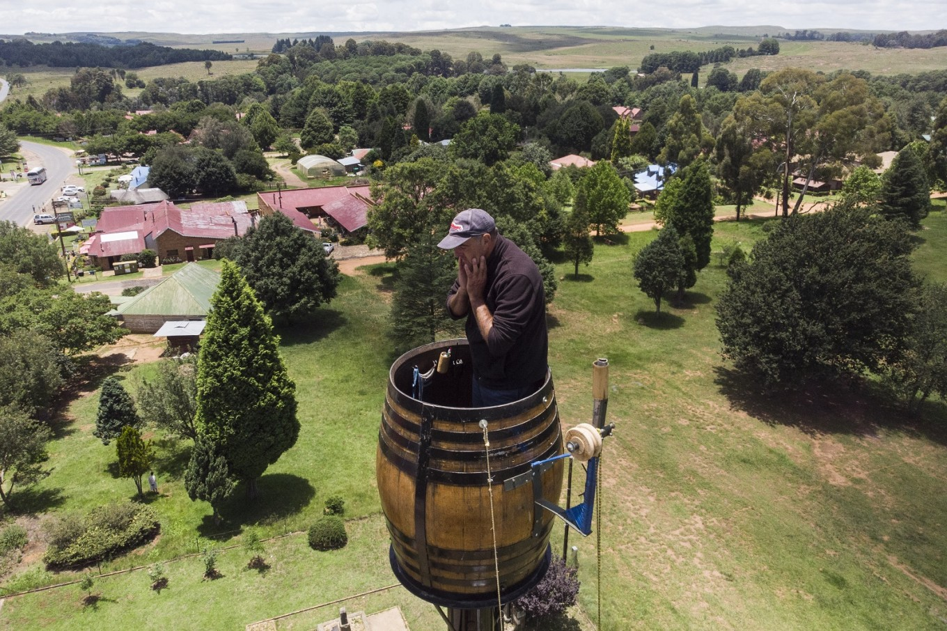 Suspended in a barrel, South African man set to break 'pole sitting' record