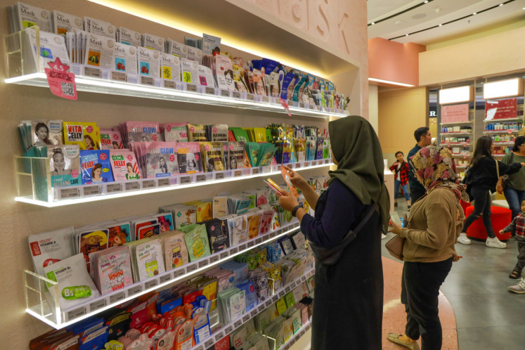 Customers browse sheet masks on display at a Sociolla store in West Jakarta.
