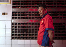 """Lukman """"Silay"""" Susanto has worked for 20 years as a temple caretaker, as well as a guide for visitors as they say their prayers. JP/Bismo Agung"""