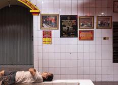 A temple caretaker sleeps during a break from work. JP/Bismo Agung