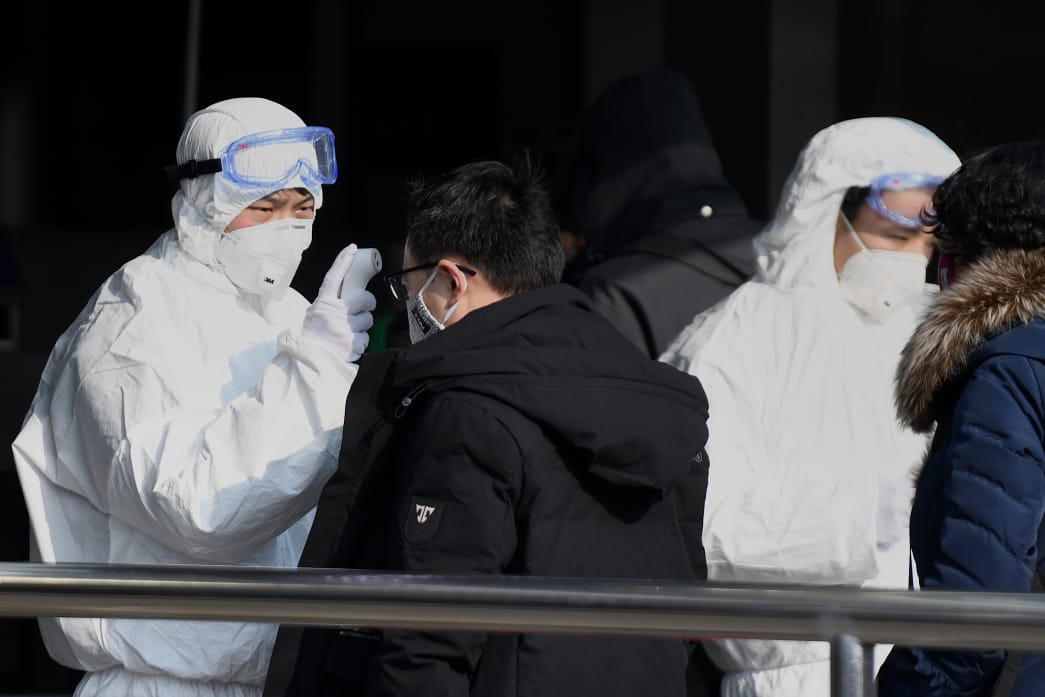 China shuts down 13 cities as virus toll climbs