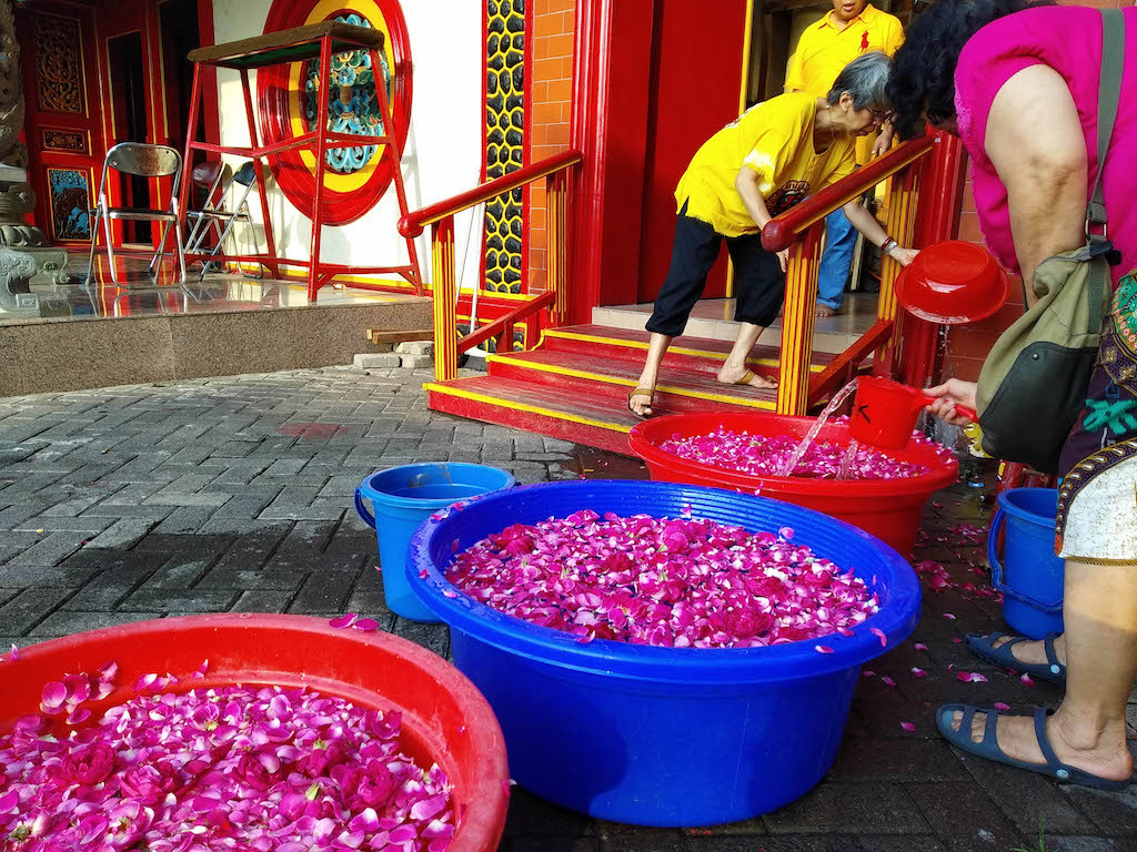 Buckets of water with flower petals are prepared for a cleaning ritual at Tjoe Hwie Kiong Temple in Kediri, East Java, on Jan. 18.