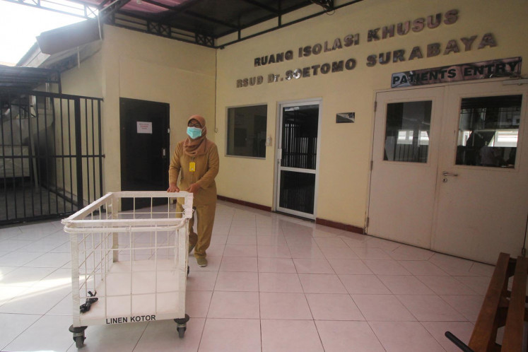 A medical officer pushes a trolley at an Isolation Room at Soetomo Regional Hospital in Surabaya, East Java, on Jan. 27. A visitor from China was being treated in the hospital but hospital officials claimed he had tested negative for the new coronavirus.