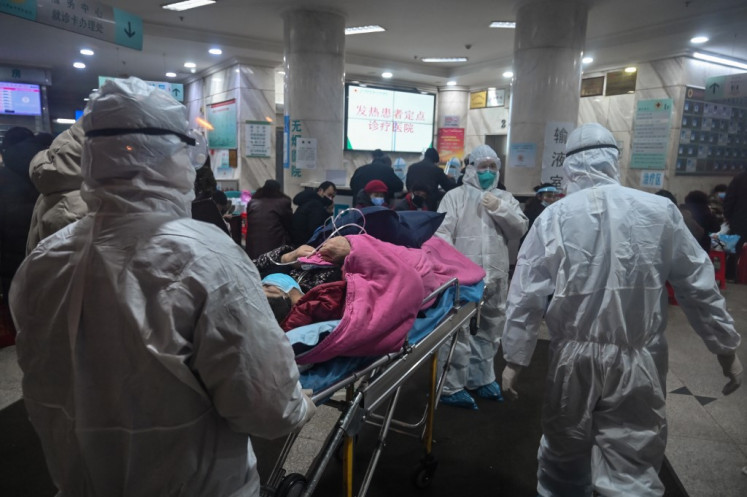 China virus death toll jumps to 106, nearly 1,300 new cases