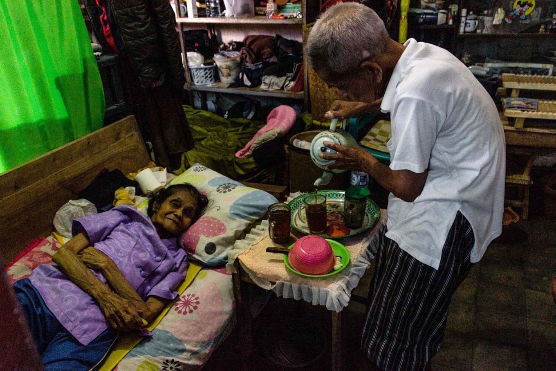 Devotion: Doel prepares drink, food and medicine for his sick wife, Yustina Sumarni, 80. JP/Anggertimur Lanang Tinarbuko