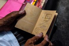Going places: A Hungarian visa stamp is seen on Doel's old passport. JP/Anggertimur Lanang Tinarbuko