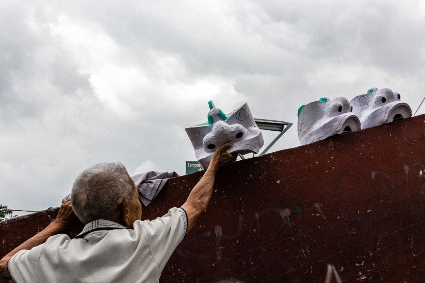 Work in process: Doel puts out barongsai lion heads to be dried in the sun. JP/Anggertimur Lanang Tinarbuko