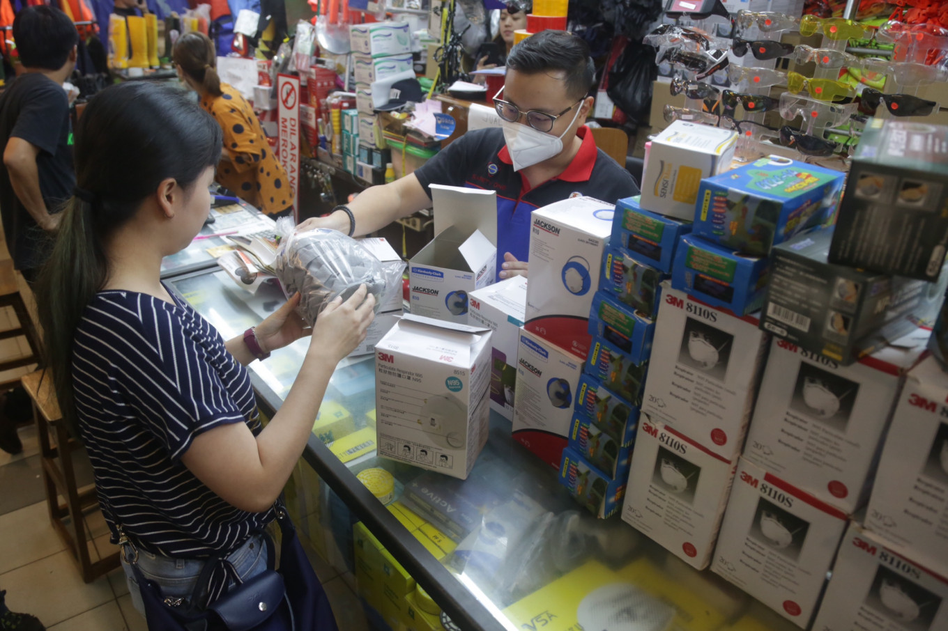 Police seize 350 boxes of face masks during raid on suspected hoarder in West Jakarta