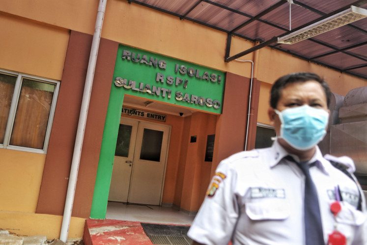 A security personnel walks past in front of the isolation room of Sulianti Saroso Infection Hospital in in Jakarta on Monday. The government has appointed 100 hospitals as referral centers in efforts to prevent the spread of the new coronavirus amid the global outbreak.