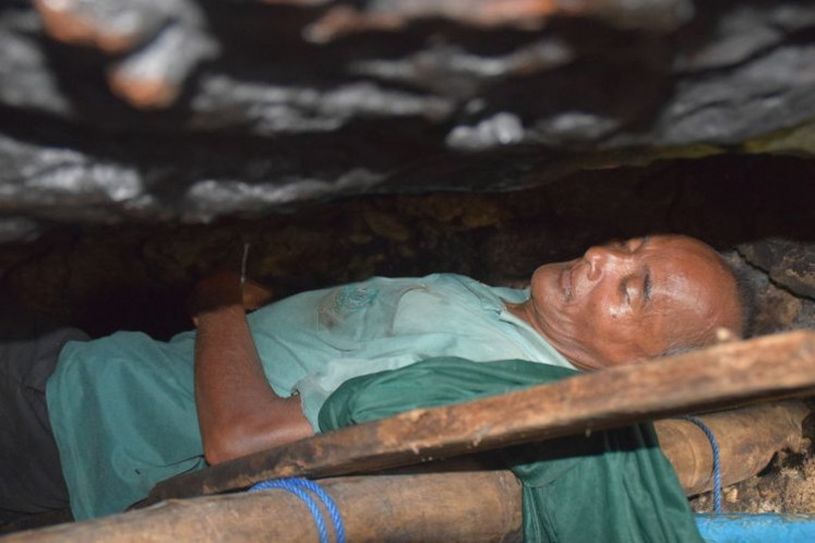 La Udu, 50-year-old resident of Baubau city in Southeast Sulawesi, sleeps in his cave. He has been living in the cave for a decade.