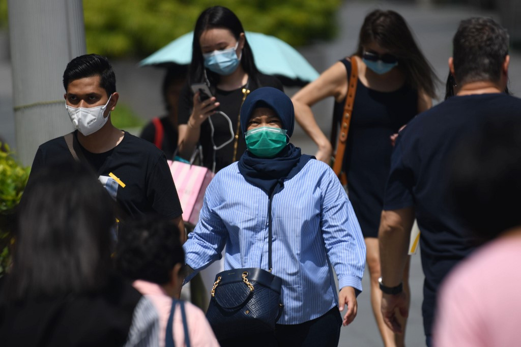 Singapore raises alert level as coronavirus cases jump to 33