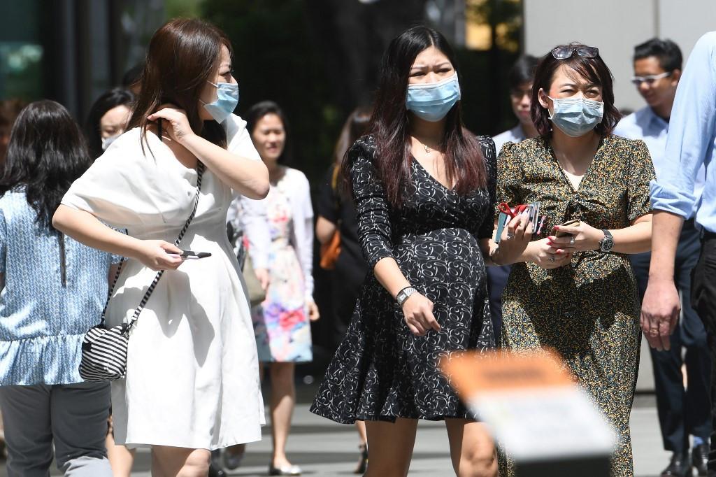 Singapore raises coronavirus alert to SARS level as new cases show spread