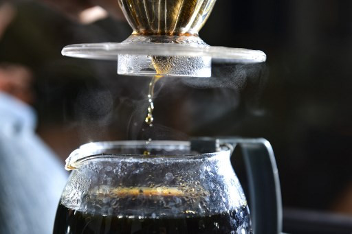 This photo taken on December 10, 2019 shows coffee roasted with marijuana brewing in Banda Aceh, Aceh province. The contraband mixture of cannabis and coffee is a hit with locals and buyers in other parts of the Southeast Asian archipelago, who pay Rp 1 million (75 USD) for a kilo of it.