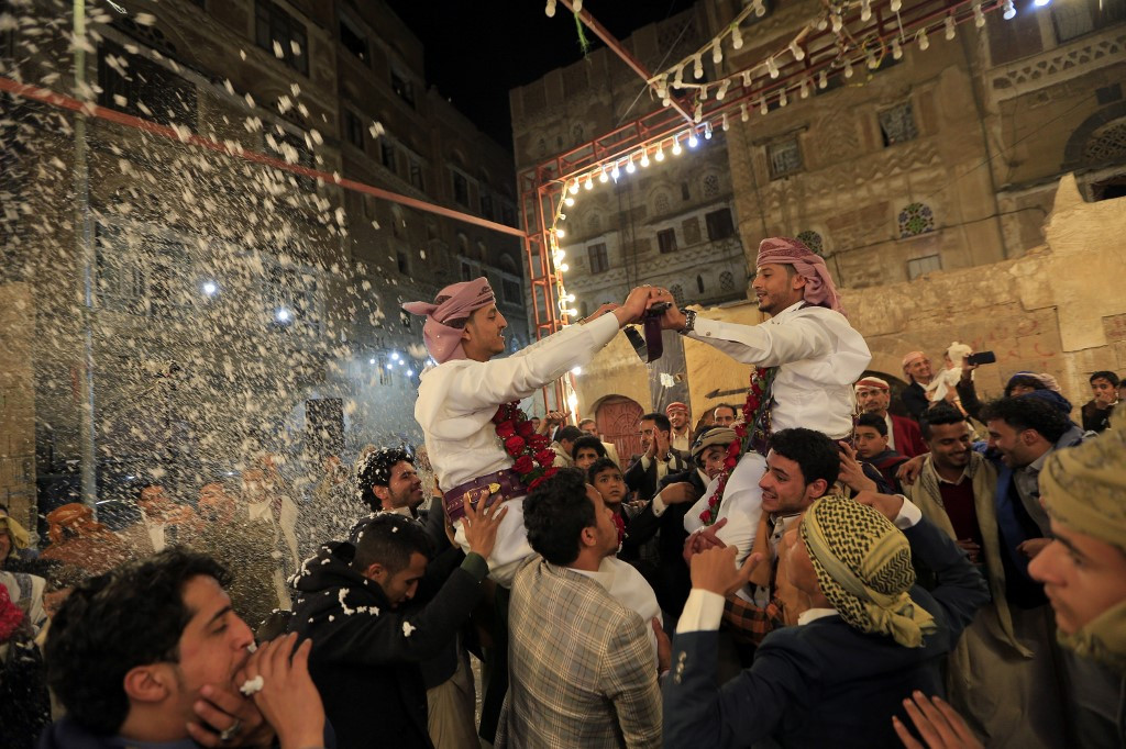 Yemenis dance at a wedding ceremony in the old city of Sanaa on December 19, 2019.