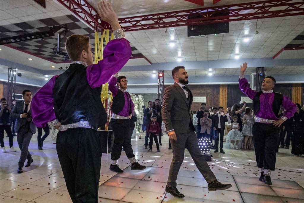 Mustafa Ramadan, a Kurdish groom, dances as he enters his wedding ceremony in the Kurdish-majority city of Qamishli in northeastern Syria on December 20, 2019.