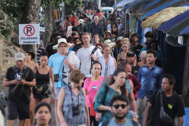 'They love to stay longer ': 600 Chinese citizens extend permits in Bali amid virus fears