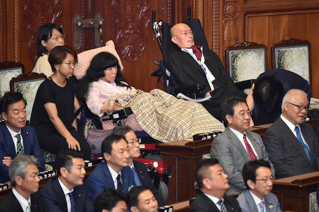 Severely disabled lawmakers in Japan fight 'invisibility'