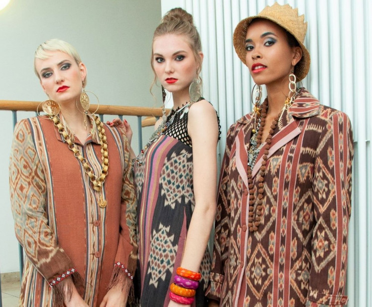 Strike a pose: Models wear Merdi Sihombing's designs during a photoshoot prior to his Berlin fashion show.