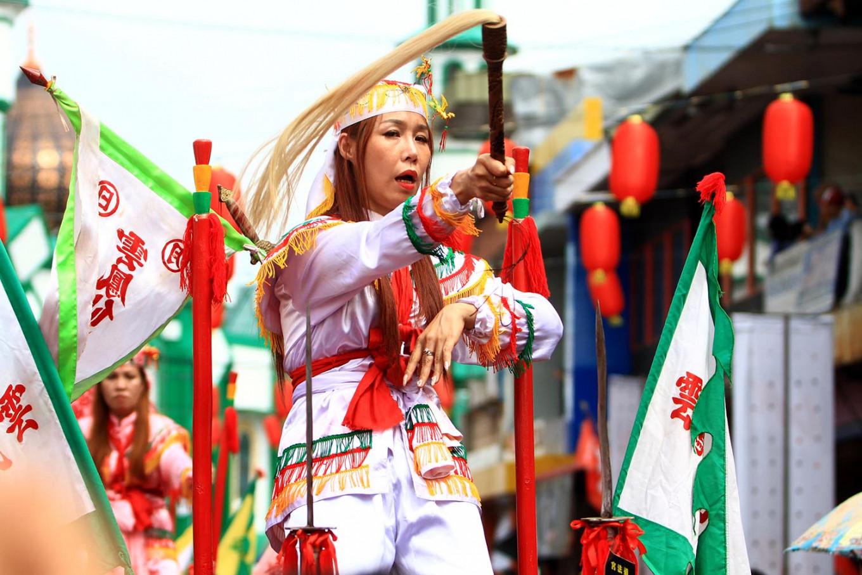 "A female tatung recites a mantra to ward off ""supernatural diseases."" JP/HS Putra"