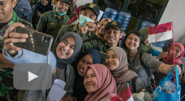 All 238 Indonesia evacuees 'healthy', head home from Natuna quarantine