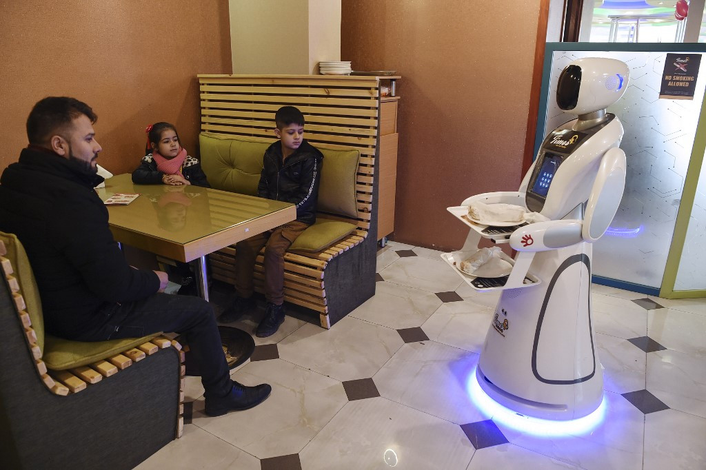 Robot waitress from Japan serves up smiles in war-torn Afghanistan