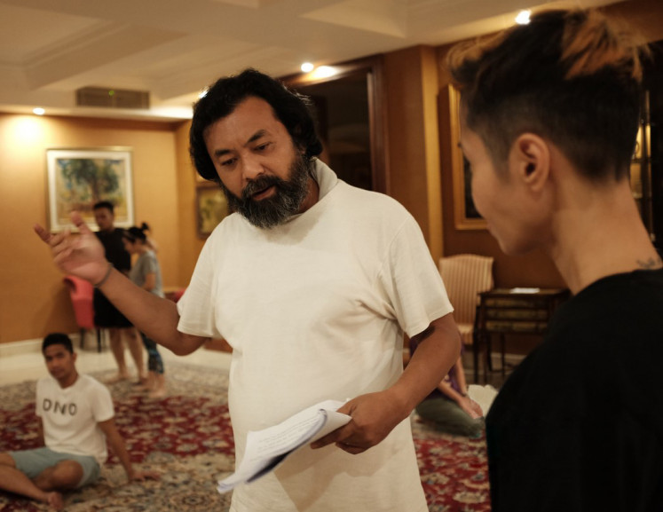 Getting into character: Kiki Narendra (left) rehearses for his role as director Teguh Santoso.