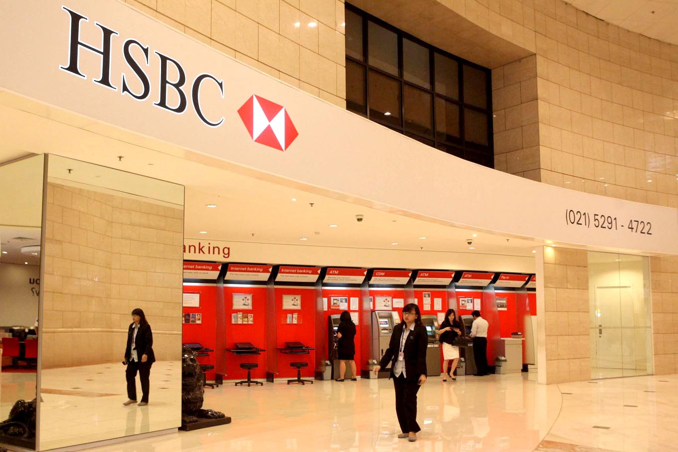 HSBC announces job cuts and radical overhaul as profits slide