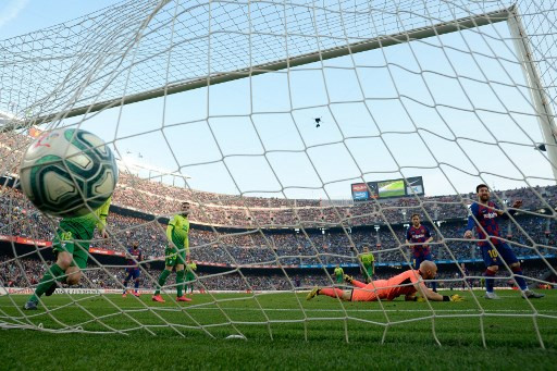 Messi scores four as Barca jump above defeated Madrid before Clasico