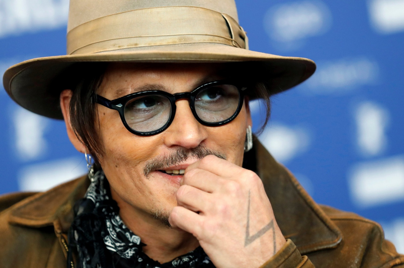Finding a purpose: Johnny Depp plays a troubled genius in 'Minamata'