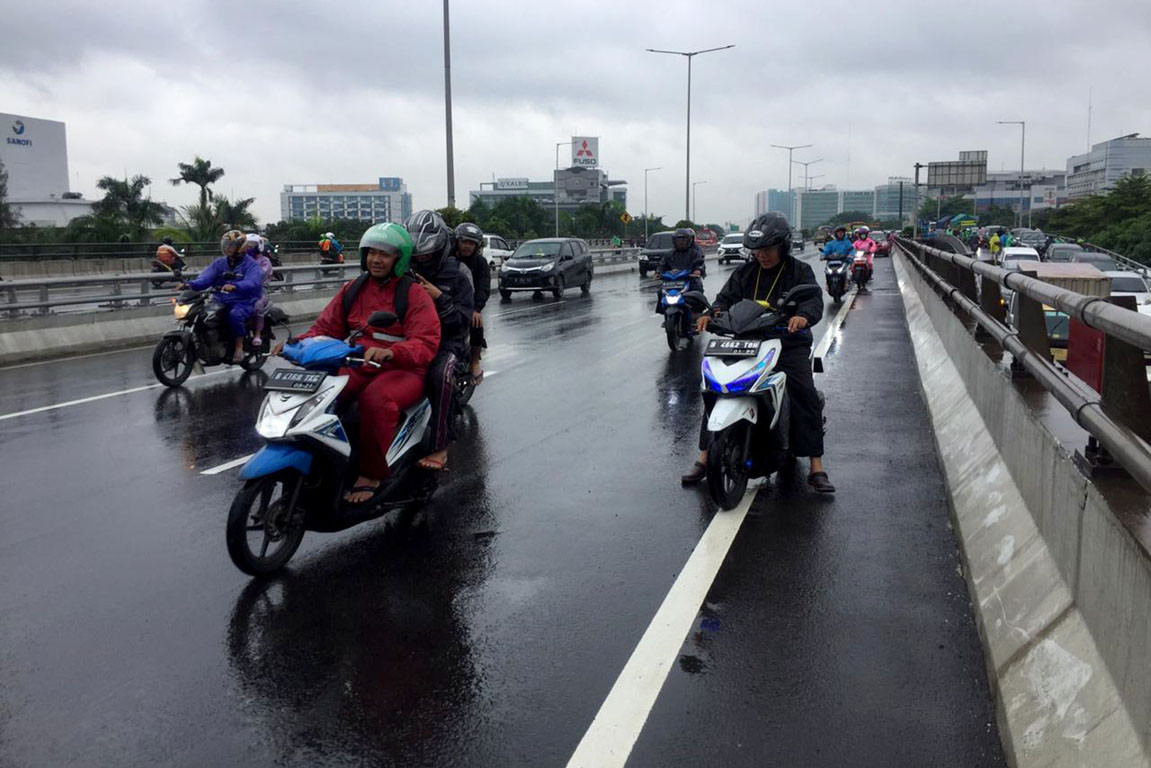 Motorist killed while driving through flood in Central Jakarta