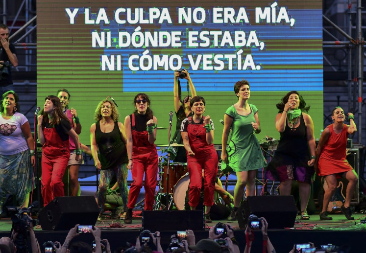 The Chilean feminist group called Las Tesis dance during a protest demanding the decriminalization of abortion at Argentina's National Congress in Buenos Aires on February 19, 2020.