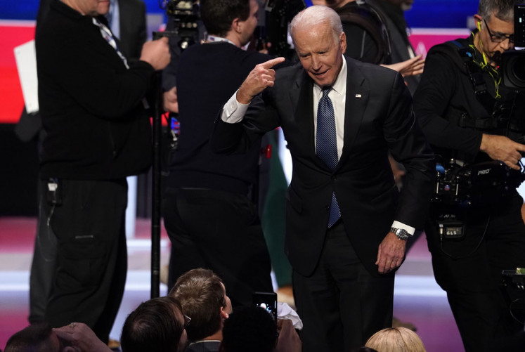 Democratic 2020 U.S. presidential candidate and former Vice President Joe Biden gestures as he speaks with members of the audience at the conclusion of the tenth Democratic 2020 presidential debate at the Gaillard Center in Charleston, South Carolina, U.S., February 25, 2020.