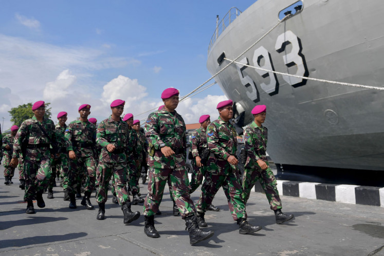 Marine Corps soldiers walked after the Indonesian Humanitarian Relief Task Force Ceremony on Sebaru Island in Mako Kolinlamil, Jakarta, Wednesday (02/26/2020). A total of 195 personnel of the Integrated Joint Task Command (Kogasgabpad) consisting of TNI-Polri, BNPB, Ministry of Health, and Seribu Islands Regency government officials were seconded to handle the observation of 188 Indonesian citizens from ABK World Dream on Sebaru Island.