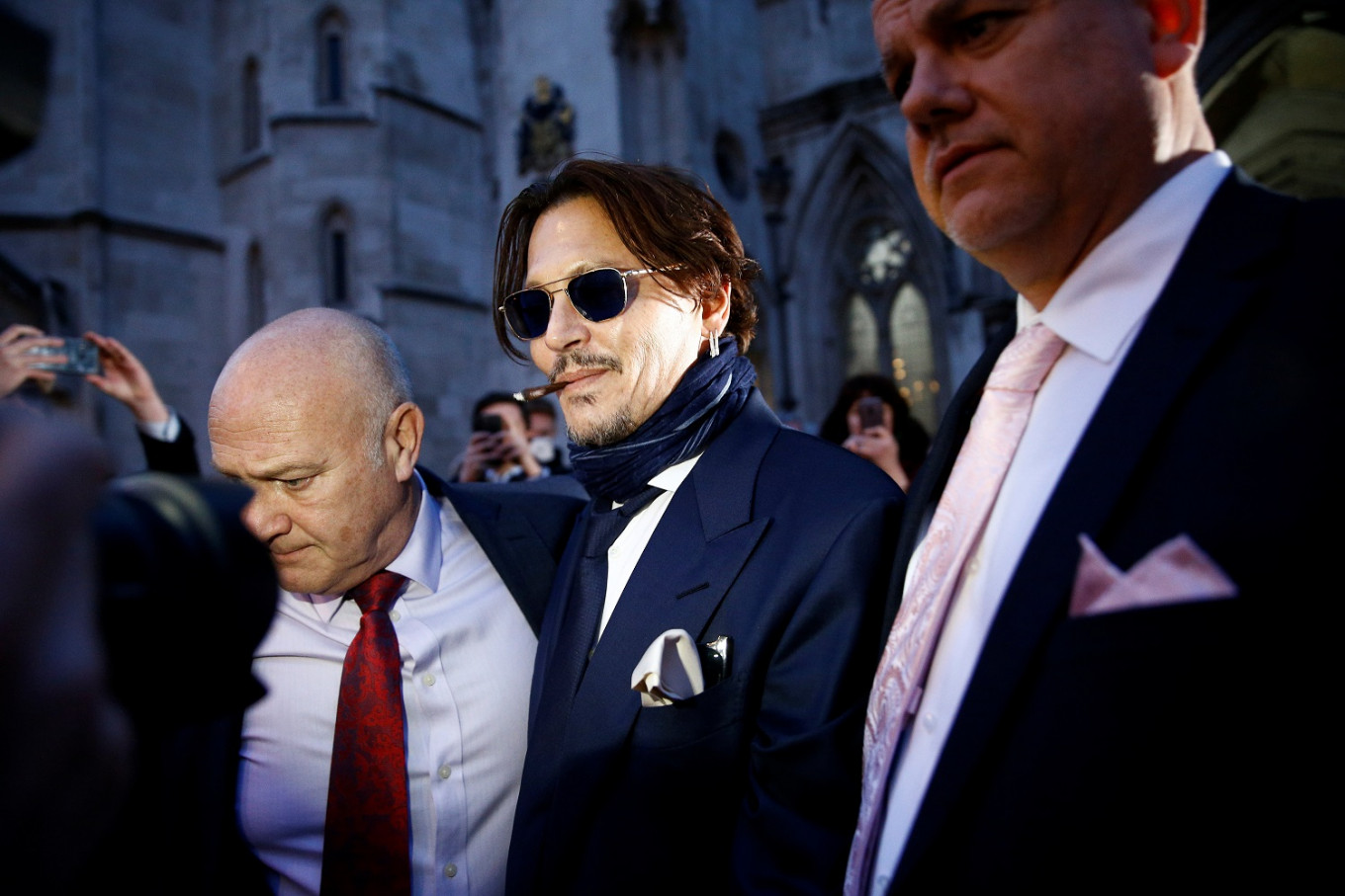 Johnny Depp takes on UK tabloid in court battle over 'wife beater' claims