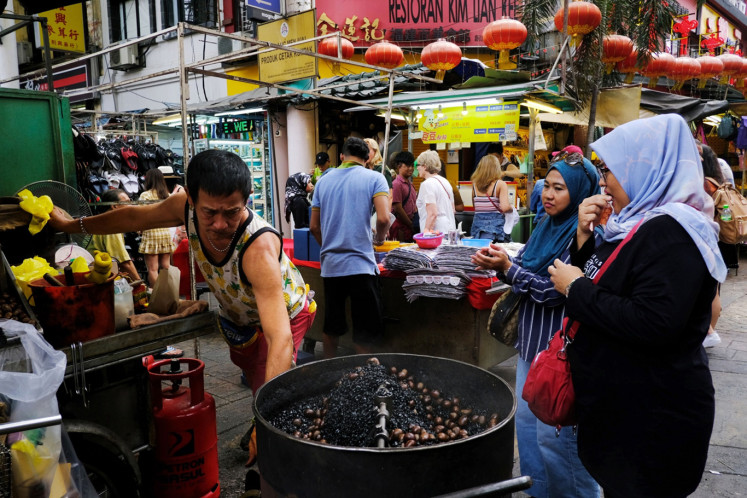 A street vendor selling roasted chestnuts on Petaling Street in the Chinatown district of Kuala Lumpur, Malaysia, on Monday, Jan. 6, 2020.