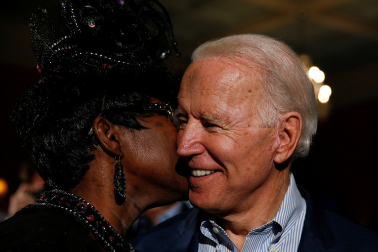 Denise Washington of Georgetown whispers into the ear of Democratic U.S. presidential candidate and former U.S. Vice President Joe Biden during a campaign event in Georgetown, South Carolina, U.S. February 26, 2020.
