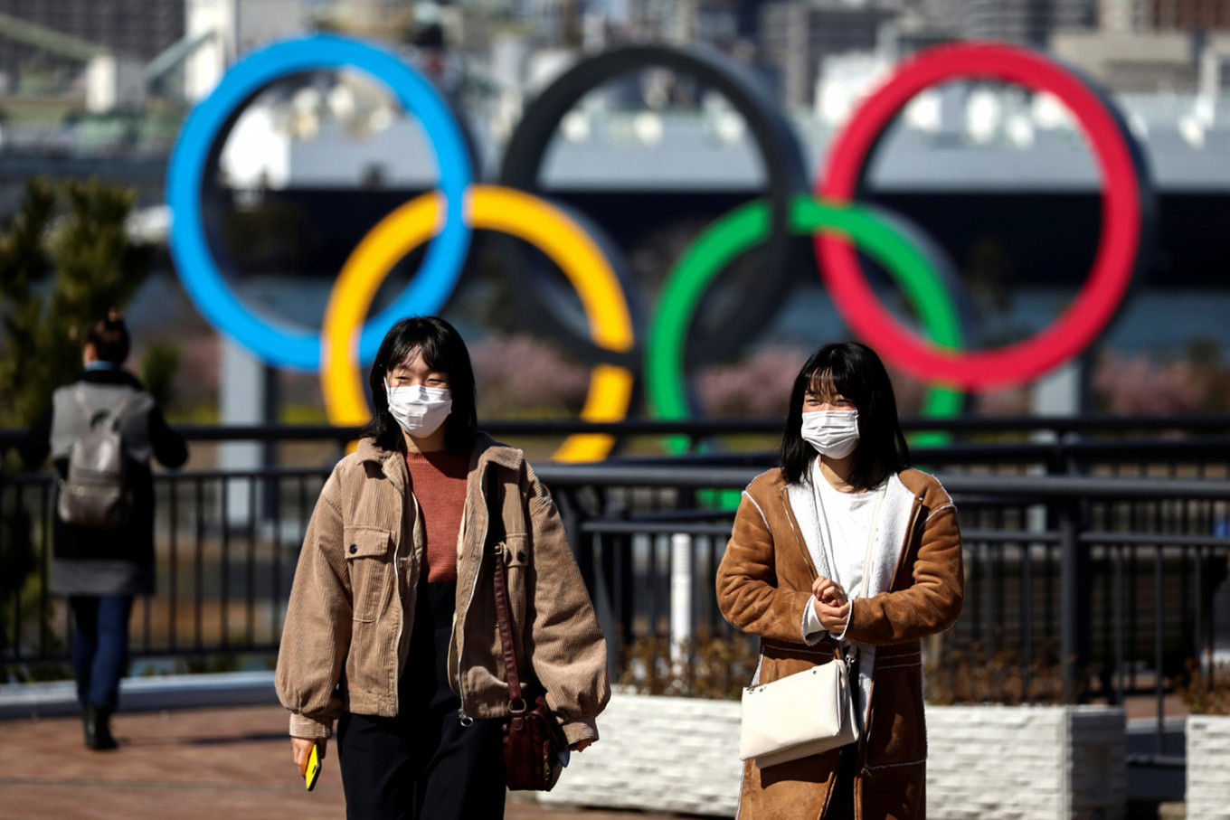 International Olympic Committee official disagrees COVID-19 vaccine needed for Olympics