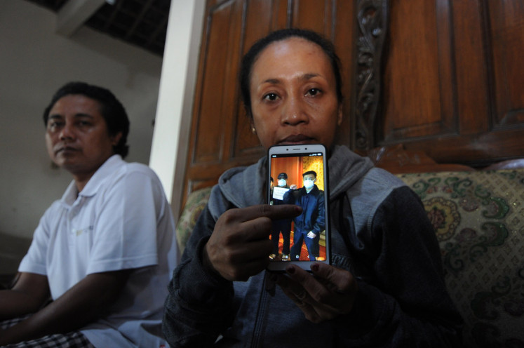 Family member shows a picture of their son Dimas Wahyu Pratama who is still aboard the Diamond Princess in Need, Mojosongo, Boyolali, Central Java, Wednesday (2/26/2020).