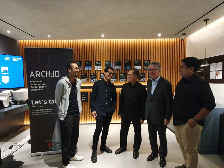 Building a dialogue: ARCH:ID curators Danny Wicaksono (left) and Wiyoga Nurdiansyah (second left) converse with Indonesian Architects Association chairman Ahmad Djuhara (center), Roca Indonesia operations director Emilio Ferrer (second right) and R. Arief Sofyan Rudiantoro of CIS Exhibition. Themed 'Let's Talk', the event is presented by the association in collaboration with event organizer CIS Exhibition with support from global sanitary products company Roca.