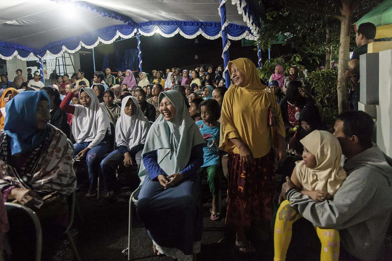 Residents gather to watch a wayang performance in Baledono district in Purworejo regency.  JP/Irene Barlian