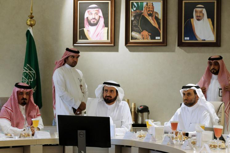 Saudi Health Minister Tawfiq Al-Rabiah, Director of Public Security Saeed Al-Qahtani and Deputy Health Minister Fahad Jalajel are seen during the Saudi Food and Drug Authority meeting in Riyadh, Saudi Arabia February 27, 2020.