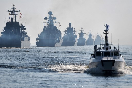 Russia sends warships to Syria, blames Ankara for killing of Turkish troops