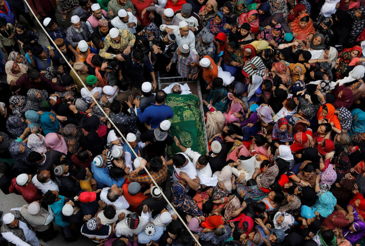 People mourn around the body of Muddasir Khan, who was wounded on Tuesday in a clash between people demonstrating for and against a new citizenship law, after he succumbed to his injuries, in a riot affected area in New Delhi, India, February 27, 2020.