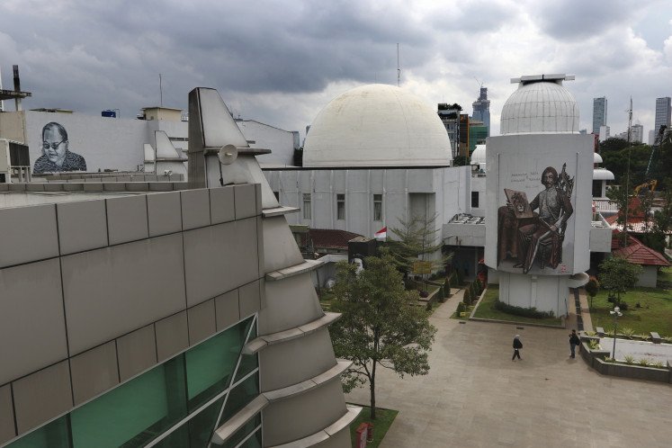 A mural of literary figure H.B. Jassin is seen on the wall of the Jakarta Planetarium at Taman Ismail Marzuki (TIM) on Feb. 20.