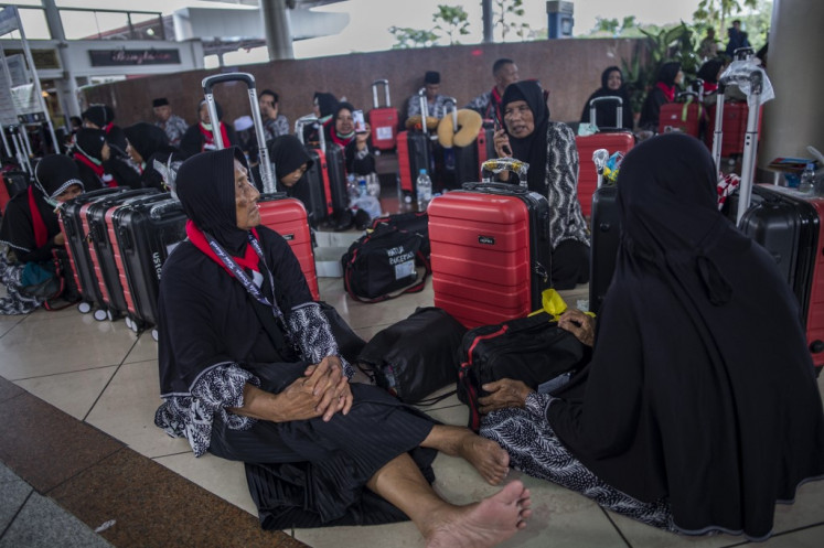 Hundreds of Umrah pilgrims piled up at Juanda International Airport in Sidoarjo, East Java province on February 27, 2020.
