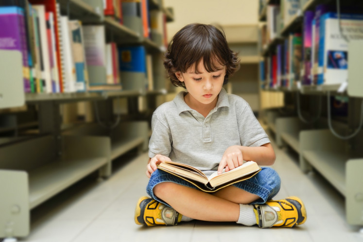 Reading a good book each day could boost kids' academic performance