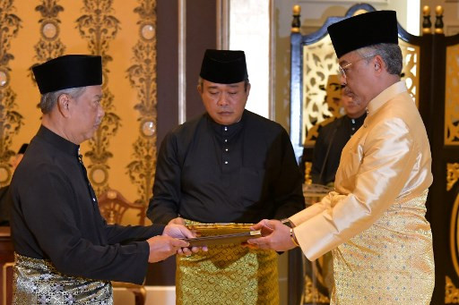 Image result for New Malaysia PM sworn in amid crisis, Mahathir fights on